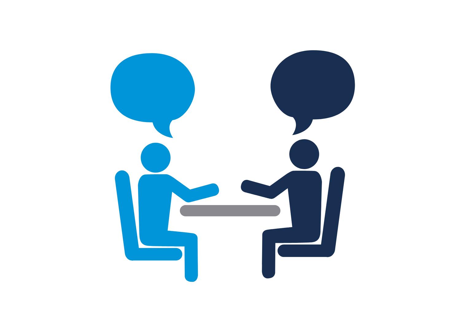 Dwie osoby rozmawiające ze sobą przy stole. Nad ludzmi znajdują się chmurki symbolizujące ich wypowiedzi